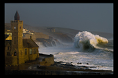 Storm wave and porthleven clock tower